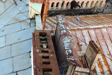 По крышам